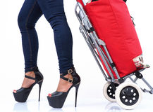 Sexy leggings and shopping trolley Royalty Free Stock Photo