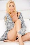 Sexy leggy blond woman Stock Photos
