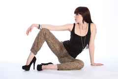 leggy fashion model sitting on floor Royalty Free Stock Photos