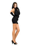 Sexy leggy young woman in black dress. Isolated Stock Image