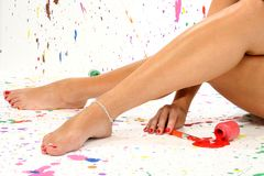 Sexy Legs. Sexy pair of legs in paint in paint splattered studio Royalty Free Stock Photo