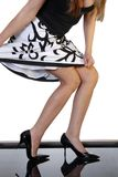 Sexy legs. With black and white patterned skirt and black stilettos Royalty Free Stock Photo