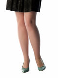 Sexy legs. Young lady sexy legs in shoes skirt Royalty Free Stock Images