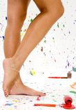 Sexy Legs. Sexy pair of legs in paint splattered studio Royalty Free Stock Photos