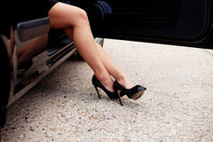 legs alighting from car Royalty Free Stock Photography
