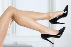 Sexy legs in black high heels shoes. Long and sexy female legs in elegant high heels shoes Royalty Free Stock Photo