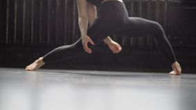 Sexy legs in black leggins of young dancer girl moves in slow motion. stock footage