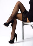 Sexy legs in black stockings Royalty Free Stock Image