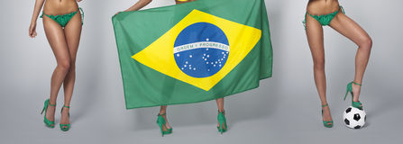 Sexy legs of Brazilian football fans Royalty Free Stock Photography