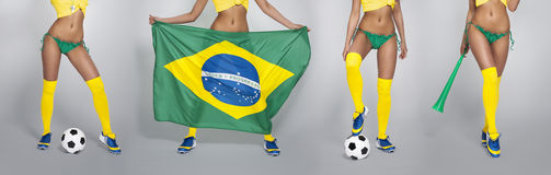 Sexy legs of Brazilian football fans Royalty Free Stock Photo