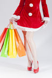 Legs of Caucasian Female Santa With Shopping Bags Royalty Free Stock Photography