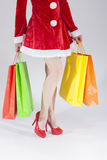Sexy Legs of Caucasian Female Santa With Shopping Bags Stock Image