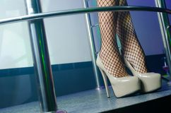 Sexy legs with fetish high heels shoes. In the night club Stock Photo