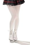 Legs of Figure Skater in White Ice Skates Stock Photo