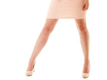 Sexy legs of girl in pink dress and high heels Stock Photography