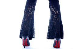 Legs and heels, closeup. Legs and heels, close-up view, lace pants royalty free stock photo