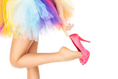Sexy legs heels and colourful skirt. A picture of a woman in a colorful ballerina skirt and pink heels posing over white background Royalty Free Stock Photography