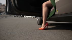 Sexy legs in high heel shoes getting out of car stock footage