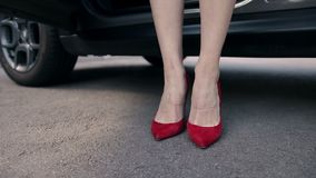 legs in high heels shoes getting out from car stock footage