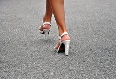 Sexy legs in high heels walking Royalty Free Stock Image