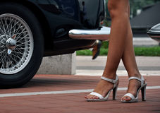 Sexy legs in high heels. Woman's legs in white high heels on the street Royalty Free Stock Images