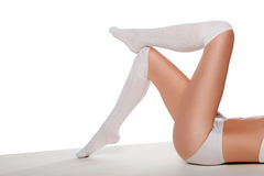 Sexy legs in knee high stockings Royalty Free Stock Image
