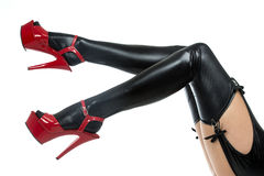 Sexy legs in latex stockings and high heels shoes Stock Photo