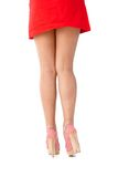 Sexy legs in mini skirt and high heels from behind. Sexy legs in red mini skirt and high heels photographed from behind Royalty Free Stock Image