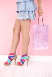 Sexy legs in multicolour sandals. Sexy legs in mini skirt and multicolour sandals Royalty Free Stock Images