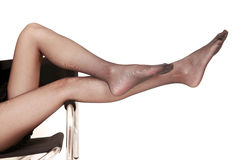Sexy legs in pantyhose. Sexy legs in black pantyhose on white Royalty Free Stock Image