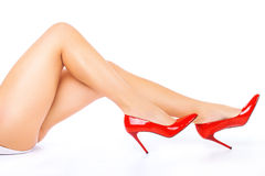 legs in Red high heels on white background. stock photography