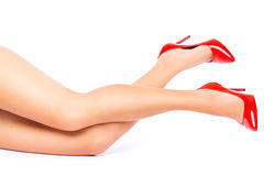legs in Red high heels on white background. royalty free stock photos