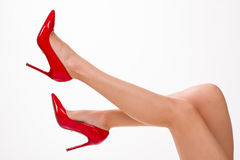 legs in red shoes. royalty free stock image