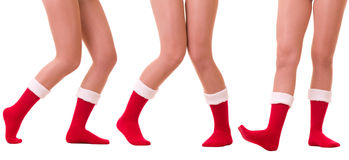 Sexy legs in Santa Claus's sock Stock Photo