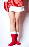 Sexy legs in Santa Claus's sock isolated Royalty Free Stock Images