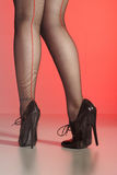 Sexy legs in seamed stockings & stilettos Stock Image
