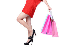 Legs of shopping lady showing shopping bag Royalty Free Stock Photography