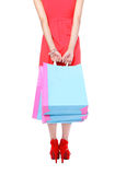 Legs of shopping lady showing shopping bag Stock Photos