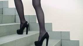 Sexy legs in stylish dark tights and shoes going upstairs. Slowly stock video footage