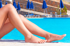 Sexy legs swimming pool Royalty Free Stock Photo