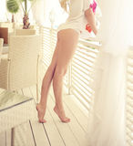 Sexy legs on the terrace. Stock Photos