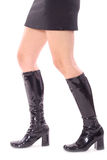 Sexy legs walking in leather boots Stock Photo
