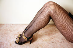 Sexy legs wearing stockings Royalty Free Stock Photos