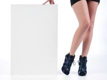 Sexy legs with white sign Royalty Free Stock Photo