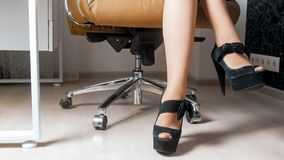 Beautiful sexy legs of young businesswoman sitting in armchair. Sexy legs of young businesswoman sitting in armchair Royalty Free Stock Photos