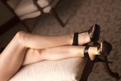 Sexy legs young lady. Sexy legs erotic sensuous semi nude young lady in bedroom Royalty Free Stock Photos