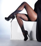 Sexy legs of a young woman in black stockings Royalty Free Stock Image