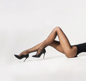 Sexy legs of a young woman in stockings Royalty Free Stock Images