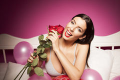 Sexy lingerie woman on the bed with valentines day decorations Stock Images