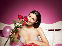 Sexy lingerie woman on the bed with valentines day decorations Royalty Free Stock Photos